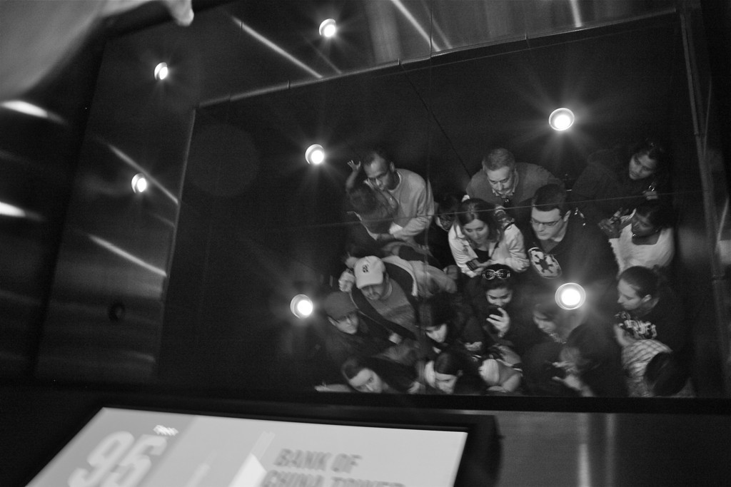"""""""Crowded to reach top""""<br /> <br /> <br /> (Shot this in the lift of Willis(Sears) Towers on the way to 103rd  floor)<br /> <br /> <br /> He stands erect by bending over the fallen. He rises by lifting others. ~Douglas Horton~"""