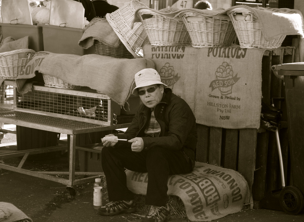 """Break Time""<br /> <br /> <br /> Took this shot in a busy local market in Sydney, where this shopkeeper was taking a break during lunch hour.<br /> <br /> <br /> ""The time to relax is when you don't have time for it.""~ Sydney J. Harris ~"