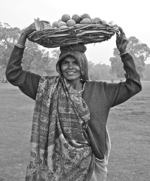 """""""Happiest Person""""<br /> <br /> Took this shot in NewDelhi, while walking by near a park. This happy fruit vendor did not hesitate to pose for a shot, though her day looked busy :-)<br /> <br /> <br /> <br /> What sunshine is to flowers, smiles are to humanity. These are but trifles, to be sure; but, scattered along life's pathway, the good they do is inconceivable.~Joseph Addison~"""