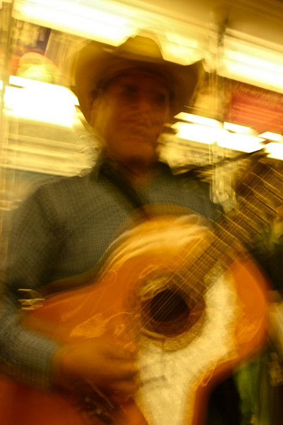 """Blurred""<br /> <br /> This is how I felt when a musician played music for a minute in a highly packed moving train in NYC and disappeared in crowd in next station even before I was going to tip him. Had no idea what he was singing. Like fast food it was fast music for a moment in NYC fast life !<br /> <br /> <br /> <br /> <br /> Music is one of the best ways to enjoy the present.  It's not much fun to look forward to hearing music or to remember what a song sounded like last week, but music right now absorbs you and places you in the moment.  ~Terri Guillemets~"