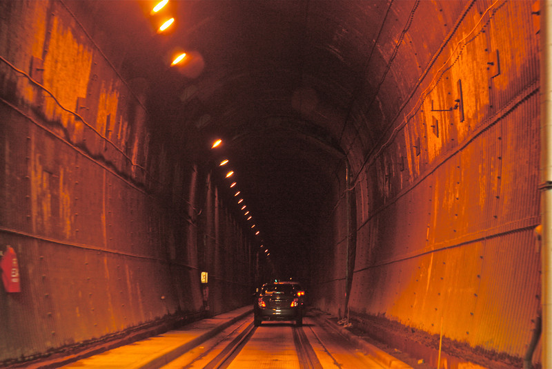 """""""Adventurous Tunnel""""<br /> <br /> Adventurous because - It is the only tunnel to go to Whittier Alaska. If for any reason this tunnel is closed, , the town Whittier is cut off from rest of the world . The tunnel has one way traffic for both vehicles and train alternating from either side of the mountain every 30 min. Whoa !<br /> <br /> Adventure is worthwhile in itself.~Amelia Earhart"""