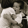 "One joyous hug !<br /> <br /> I took this shot when I went to a small town center concert. Interestingly the kids dancing in front  of the stage were more center of attraction than the band :-) Though I love the essence of the shot  I am not very happy with the crop of this picture as this was a totally unexpected shot and I couldn't bring the subject in the center of the frame. I was playing 'yes' 'no' in my mind before posting, and finally decided to post :D<br /> <br /> <br /> <br /> ""Joy is the feeling of grinning inside."" ~  Melba Colgrove ~"