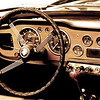 """ Pure Classic ""<br /> <br /> I am not sure about the model or year but this car is classic british car Triumph.I felt it carried history when I saw it parked on the road. I just loved the old style dashboard, so I  tried giving it the 50's look.<br /> <br /> <br /> <br /> ""If a man does not know what port he is steering for, no wind is favorable to him""~Seneca~"