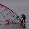 Mar 29/09<br /> Took this shot at a lake near by when I saw this guy on his sail. I thought of taking a good shot of the sail but he almost sank and had to come back to the shore due to lack of wind.