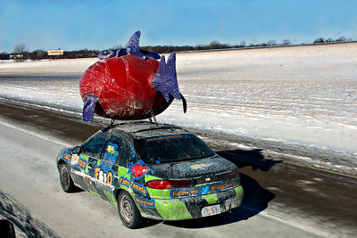 Salted GMO, While on my way to Indianapolis  I passed a caravan of these cars dressed up against GMOs  genetically modified food products,snapped this one as i was passing  the lead car.I wonder where they were goin to protest ?
