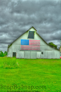 Old barn with an American flag