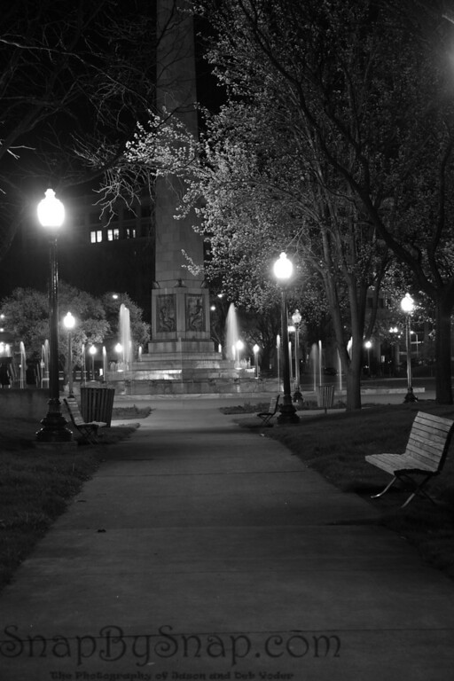 Night time in a city park.    This was actually taken at around 6 am in the War Memorial plaza in Indianapolis.