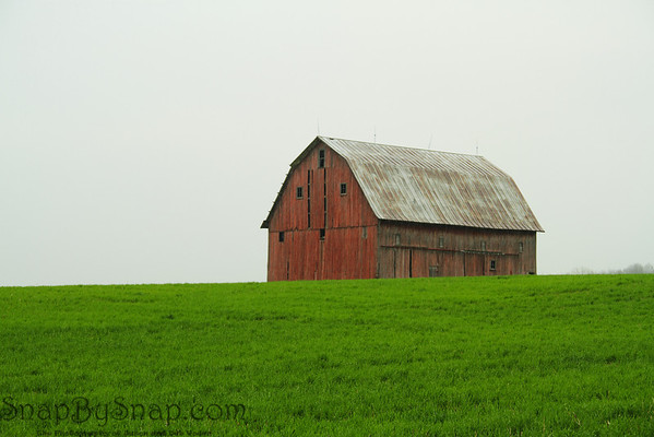 Barn on Hill  This barn has been capturing my eye for the last year.  I've been driving past it on my way between Indianapolis and Fort Wayne.  I finally took a detour off the interstate and found it.  Even though it was raining, the image can out pretty good.  Drove by this site the other day.  This barn is now history.