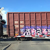 Some graffiti on a railway car going by
