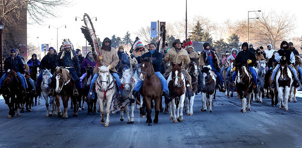 Dakota riders make their way down Riverfront Drive toward Reconciliation Park before a ceremony commemorating the 150th anniversary of the hanging of 38 Dakota in Mankato Wednesday, Dec. 26, 2012. The riders left South Dakota on Dec. 10 for Mankato.