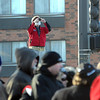 A man gets a better vantage point on Wednesday's ceremony at Reconciliation Park.