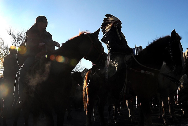 Riders sit atop their horses during a ceremony at Reconciliation Park in Mankato Wednesday, Dec. 26, 2012 commemorating the 150th anniversary of the hanging of 38 Dakota men in Mankato in 1862.