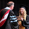 Jaydica Marie Morris receives her diploma from Paul Garrison during Daleville's graduation on Friday.