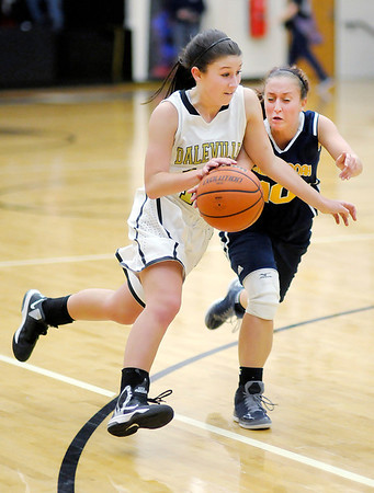 Daleville's Jaime Roberts drives to the basket as Shenandoah's Megan Chapman reaches for the ball as the Broncos hosted the Raiders on Thursday.