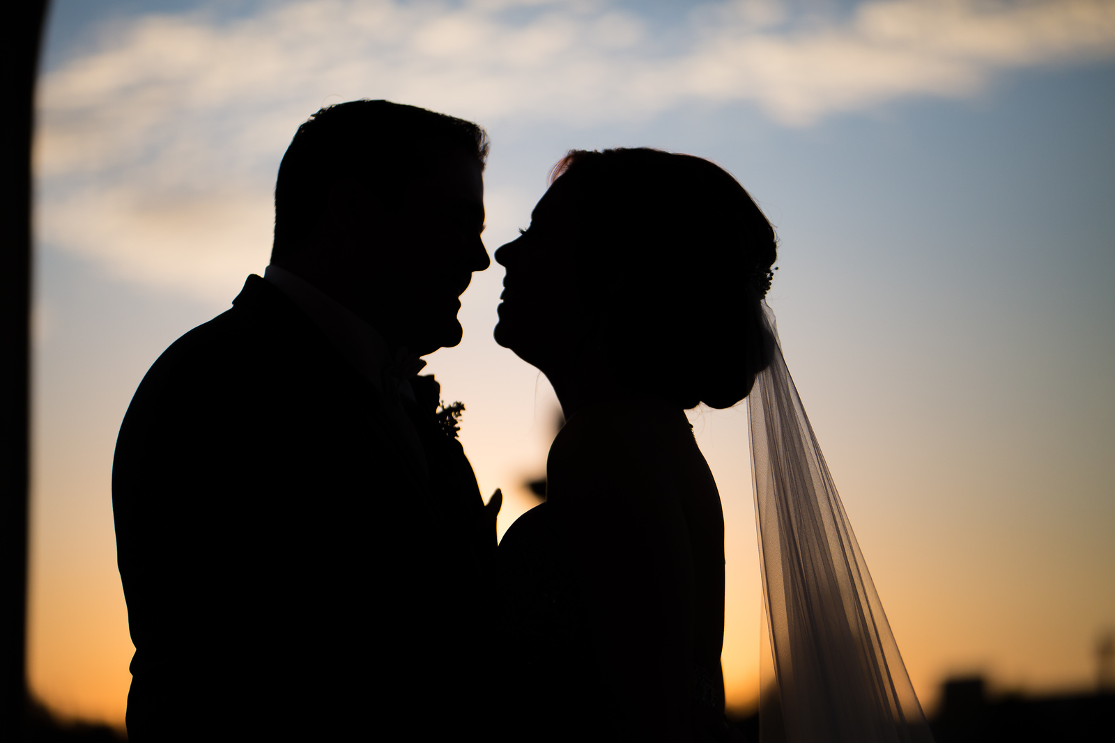 sillouette of a bride and groom at sunset