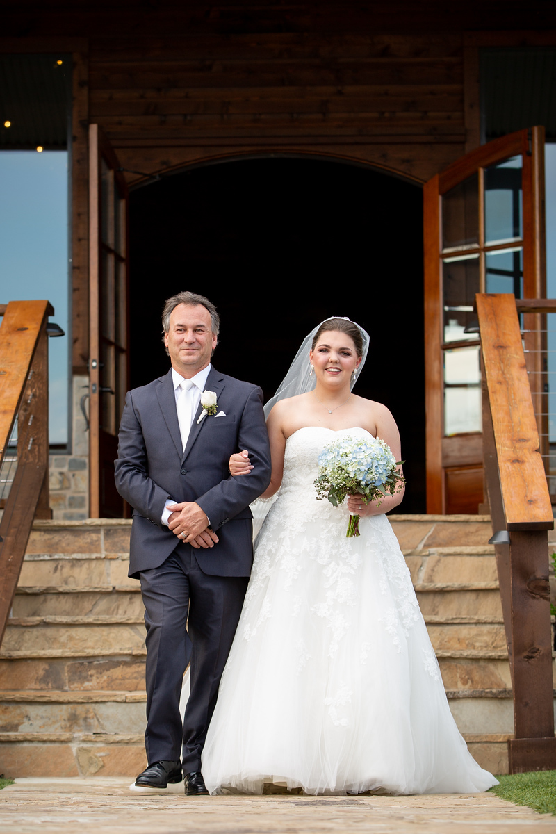 bride being walked down the aisle by her father on her wedding day