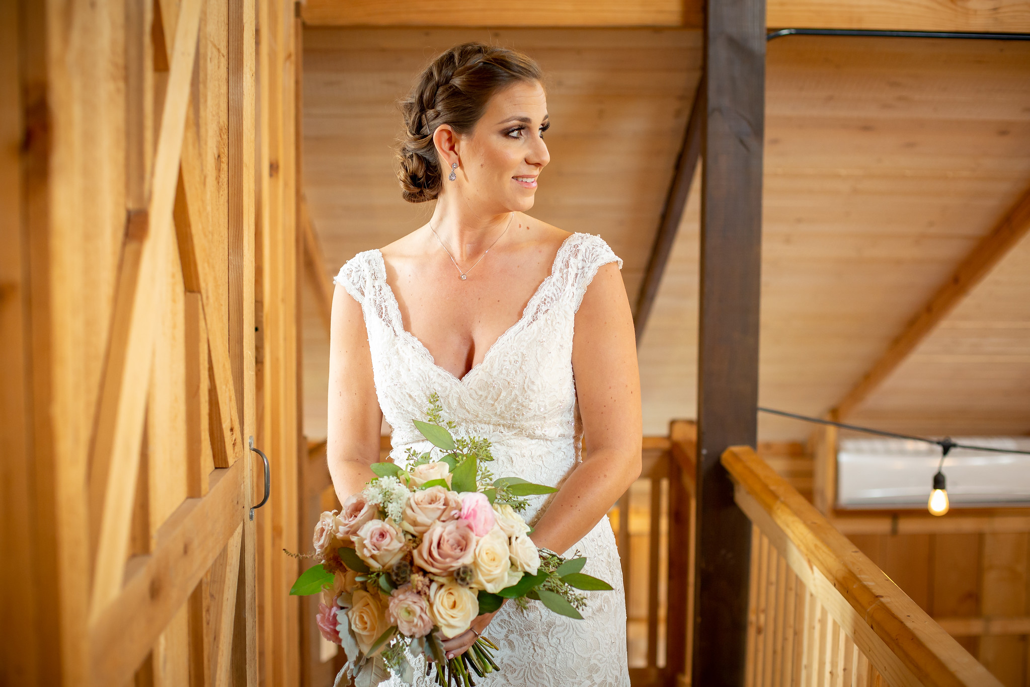 bride standing on a natural wood balcony