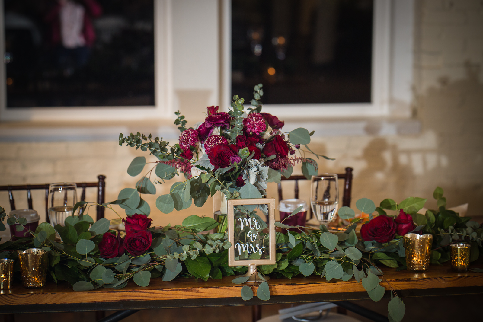 rose and greenery wedding head table centerpiece
