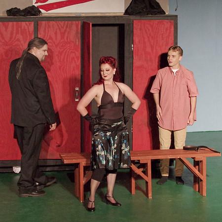 "Mark Maynard | for The Herald Bulletin<br /> Mr. Applegate (Sean Smith) introduces Lola (LIz Justice) to Joe (Brandon Dubois) in ""Damn Yankees."""