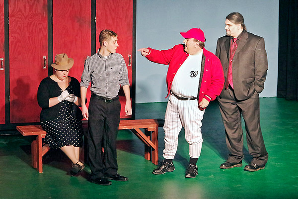 "Mark Maynard | for The Herald Bulletin<br /> Reporter Gloria Thorpe (Kirby Gilliam) takes notes as Joe Hardy (Brandon Dubois) is introduced to Van Buren (Scott McFadden), Manager of the Washington Senators, by Mr. Applegate (Sean Smith) in ""Damn Yankees."""