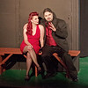 """Mark Maynard   for The Herald Bulletin<br /> Sultry seductress Lola (Liz Justice) listens intently as her boss, Mr. Applegate (Sean Smith), lays out his devilish scheme to ensnare Joe's soul for eternity in """"Damn Yankees"""" at Anderson's Mainstage Theatre."""