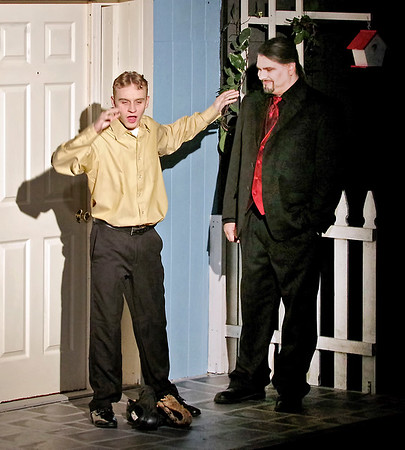 "Mark Maynard | for The Herald Bulletin<br /> Having struck his bargain with Mr. Applegate (Sean Smith), middle-aged baseball fan Joe Boyd is amazed at his tranformation into the young Joe Hardy (Brandon Dubois) in ""Damn Yankees."""