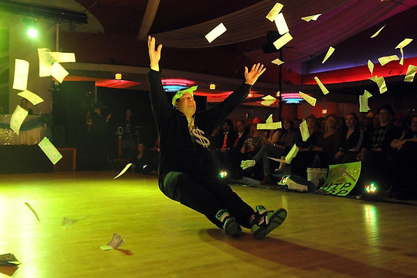 Dave Thompson falls while throwing fake money during Dancing With the Mankato Stars Saturday.
