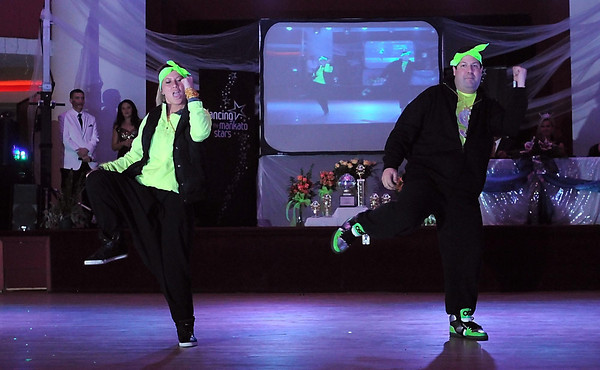 Whitney Waugh and Dave Thompson dance to a hip hop tune during Dancing With the Mankato Stars Saturday.