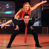 Emma Glaser flies over Scott Bergs while dancing to a Latin jazz number during Saturday's Dancing With the Mankato Stars.