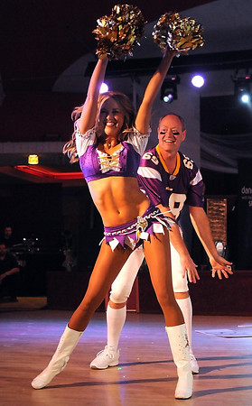 Minnesota Vikings cheerleader and Mankato native Kaylee Munson dances with her father Dave during Saturday's Dancing With the Mankato Stars.