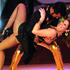 Kate Cox and professional dancer Eddie Rodriguez dance a disco number during Dancing With the Mankato Stars Saturday.