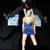 Pat Christman<br /> Travis Shafer leaps over his partner Angie VanEman during Dancing with the Mankato Stars Saturday.