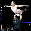 """Pat Christman<br /> Buster's owner Matt Little lifts Whitney Waugh in the air mimicking a scene from the movie """"Dirty Dancing"""" during Dancing with the Mankato Stars Saturday at the Verizon Wireless Center."""