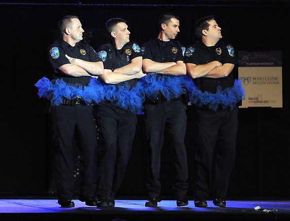 """Pat Christman<br /> A quartet of Mankato Police officers don tutus as part of """"Guns and Hoses"""" during Dancing with the Mankato Stars Saturday."""