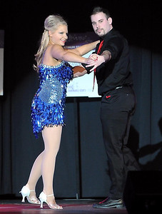 Pat Christman Angie VanEman and Travis Shafer dance during Dancing with the Mankato Stars Saturday.
