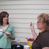 The neighbors, Karen and Debra, trade stories.