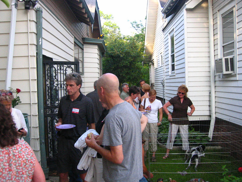 What a little backyard looks like with lots of people crammed in it -- and a puppy.