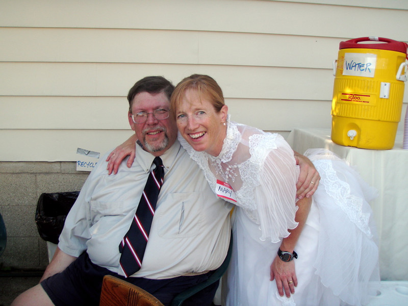 The lovely couple.  I hadn't put the dress on in 25 years and was glad I could still get it zipped.  As to how to roll up the train in the back -- forget it.  Lorraine was kind enough to safety-pin it in place.