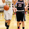 Daleville's Brynn Gooding tries to avoid touching the ball after it was knocked out of bounds by Wapahani's Angelica McKibben as the Broncos hosted the Raiders on Thursday.