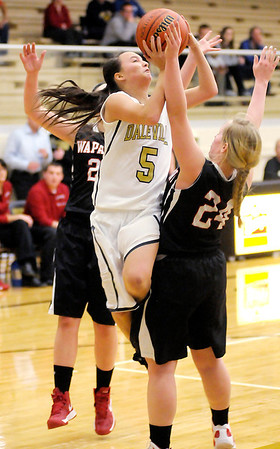 Daleville's Brandi Granger shoots over the defense of Wapahani's Paige Williamson as the Broncos hosted the Raiders on Thursday.