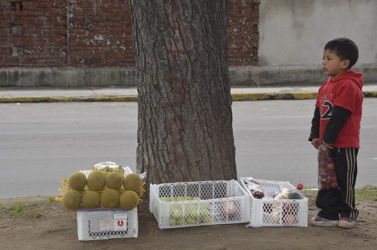 Boy Selling Fruit