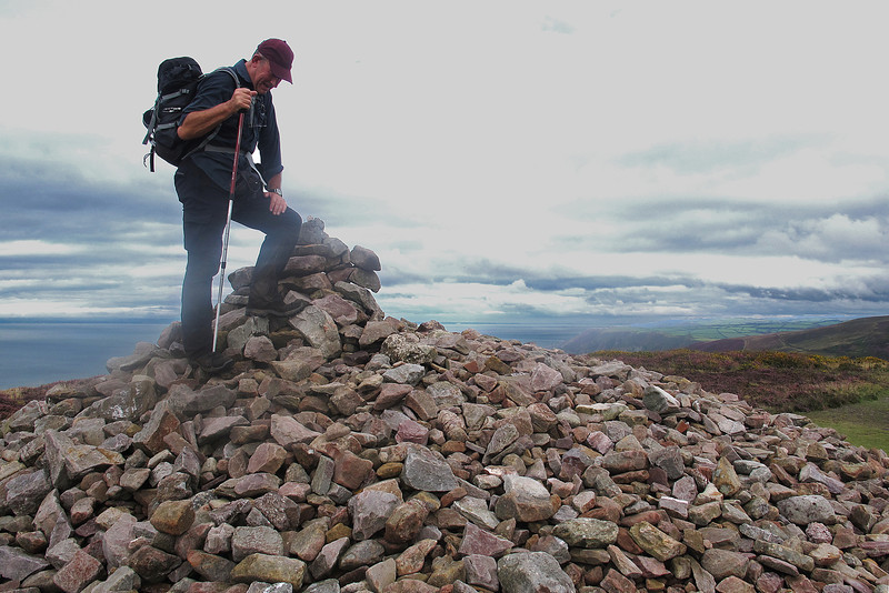 Our intrepid explorer on the cairn at the Great Hangman, highest point on the South West Coast Path at 318 metres (1043 feet).