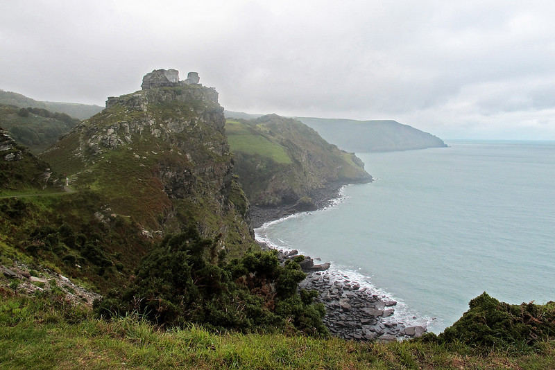 Castle Rock broods over the coast.