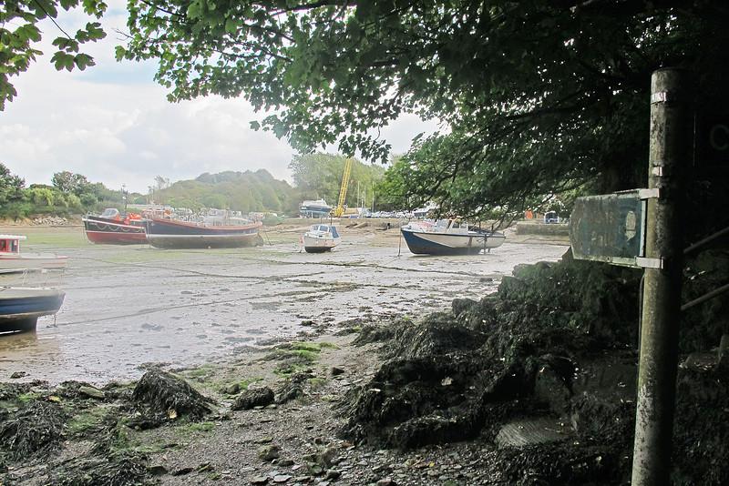 At low tide (like this) the footpath passes across the end of Watermouth.   Note the two elderly retired lifeboats left of centre.