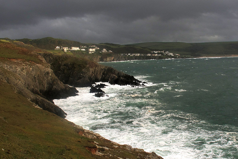 The destination today lies just round the headland right of centre - the torrential rain will arrive before reaching it!