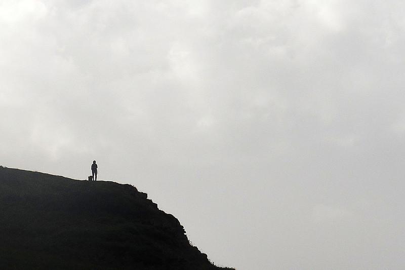 A lone walker on a rise near Morte Point.