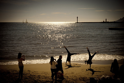 Acrobats on the beach of La Croisette in Cannes, France