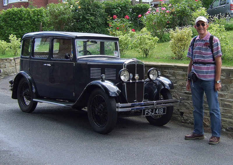 A Standard 'Big 9' saloon circa 1933 with admirer.   This is very similar to the Morris 10 my dad had when I was a child.