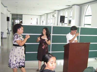 Lychell Gabuco (left) signing with her deaf sister, Cheard.  Lychell works with her deaf sister in pioneering ministry to Deaf in the Manila area.