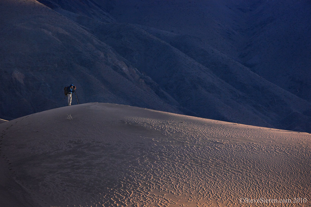 Photographer in the remote Panamint Dunes in Death Valley